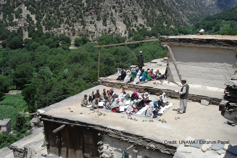 NURISTAN, 07 November 2016 - A primary school class takes place in the open air, on the flat roof of a building, in eastern Nuristan province. Largely agricultural, the province is located on the southern slopes of the Hindu Kush mountains. Photo UNAMA / Ebrahim Papal.